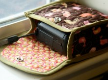 Here is a great tutorial on how to make a cute little quiltedCozy Camera Casefor your point and shoot camera. This one fits a camera that is 4.3″ by 3.0″ by 1.8″, so will fit any camera up to that size, or smaller. You can also adjust the size of the pieces veryeasily to make a case for a larger or smaller camera.