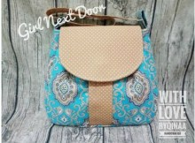 The Girl Next Door is a simple, easy to make, adorable handbag/shoulder purse bag suitable for a walk in the park or shopping in town. The practical part of this bag is also its main feature - a large concealed front pocket. Unless you look very closely you will not realize it is there.