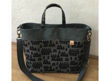 Here's your chance to create your own beautiful everyday purse named the Melinda Handbag. Melinda can be made by an advanced beginner sewer and has the following features: two exterior slip pockets, one interior zipper pocket, one interior slip pocket, a magnetic snap closure and a removable, adjustable strap.