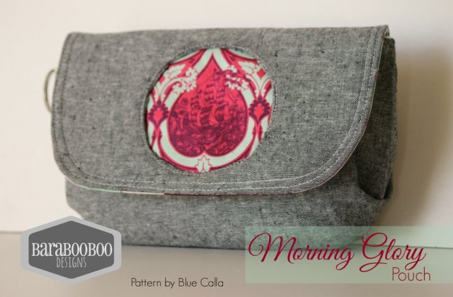 The Morning Glory Pouch has the following features: It's a small pouch It has a flap that has amagnetic snap closure There are pleats on the bottom to give the pouch some depth There is a reverse applique circle on the flap that allows you to feature a small piece of your favourite fabric The pattern's instructions include a small slip pocket inside