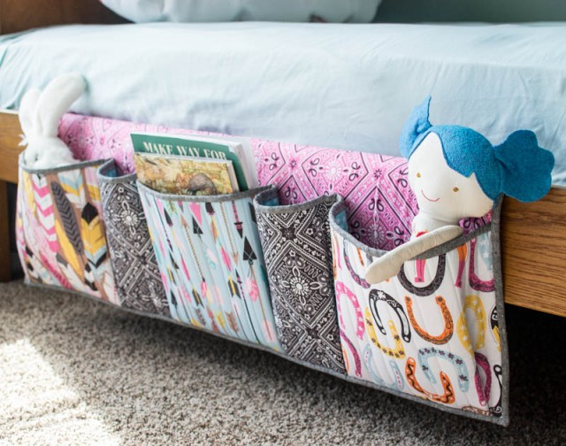 free sewing pattern for a bedside organiser that slips under the matress to keep books, magazines, toys, glasses etc