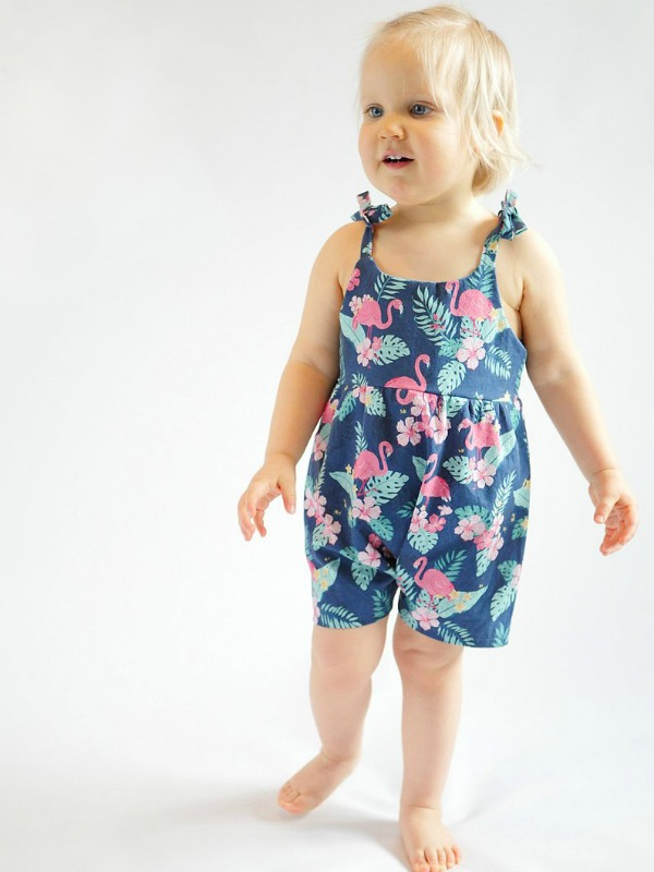 This is definitely one of our favorite designers here at Sew Modern Bags because she makes excellent digital patterns at amazing prices. This is a playsuit or romper sewing pattern for babies and toddler girls that comes with ties on the shoulders and no snaps at the crotch, which makes it an easy to sew project.