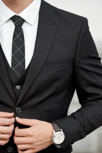 Man in custom tailored business suit posing