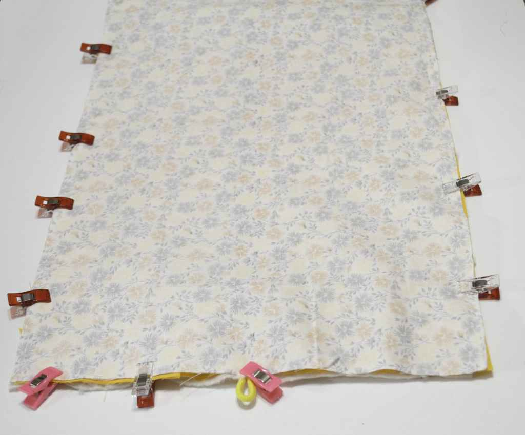 Layer main fabric, batting, lining, and hair tie, sew crafty Travel