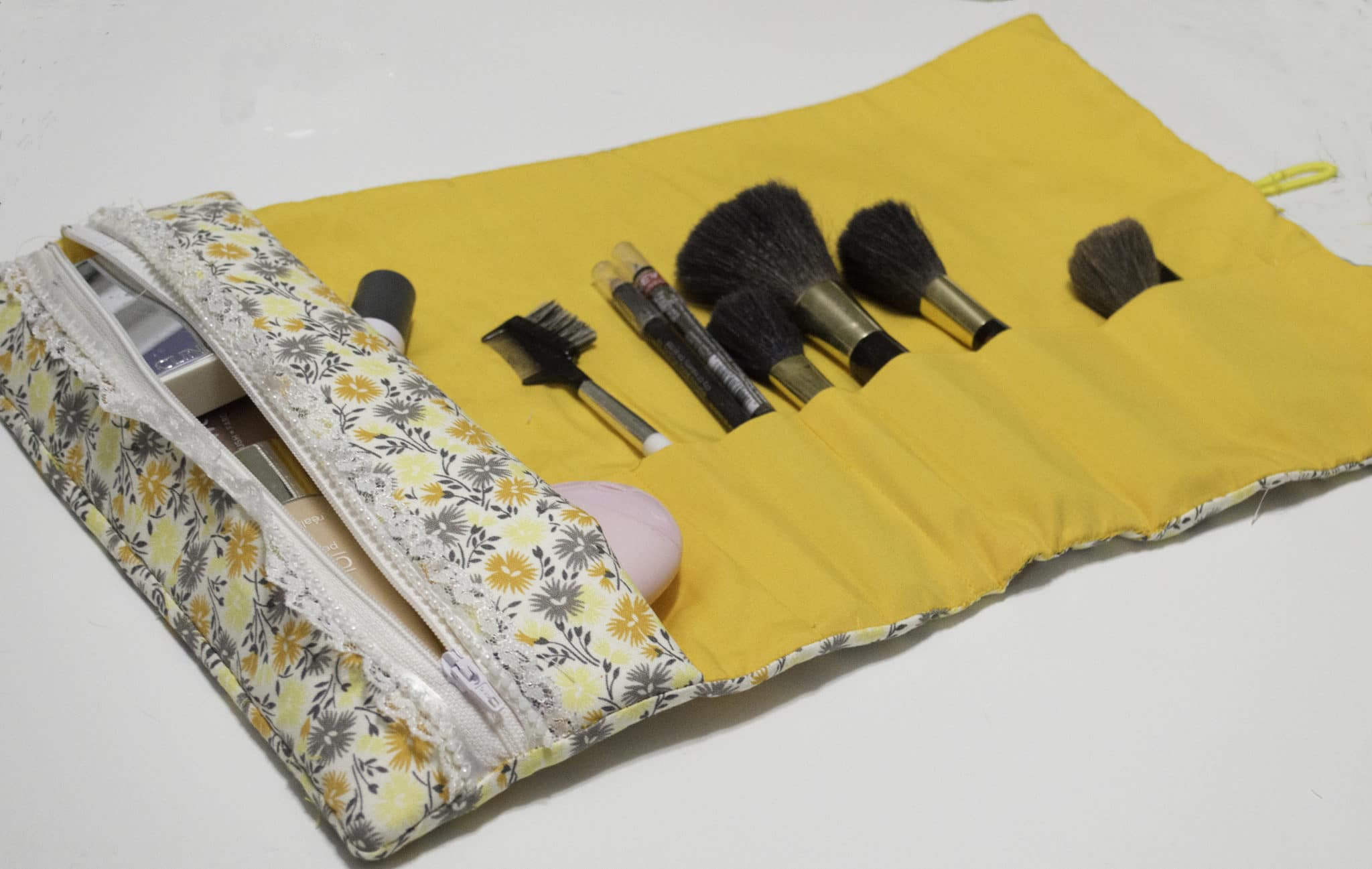 Open rollup makeup pouch and brush caddy