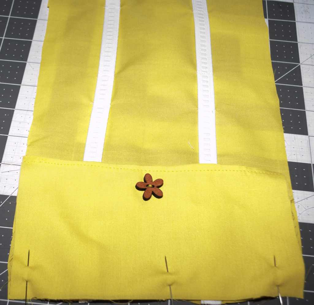 Sew two lines of elastic and a decorative button, Sew Crafty Travel