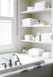 Open-shelving-at-end-of-bathtub-in-white-chic-bathroom-1-206x300 16 Organizing Tips