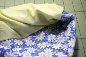 Pull-the-Main-Fabric-Right-Side-Out-Turning-the-Cuff-Fabric-to-the-Right-Side-300x200 How to Make a Pillow Case in 5 Easy Steps