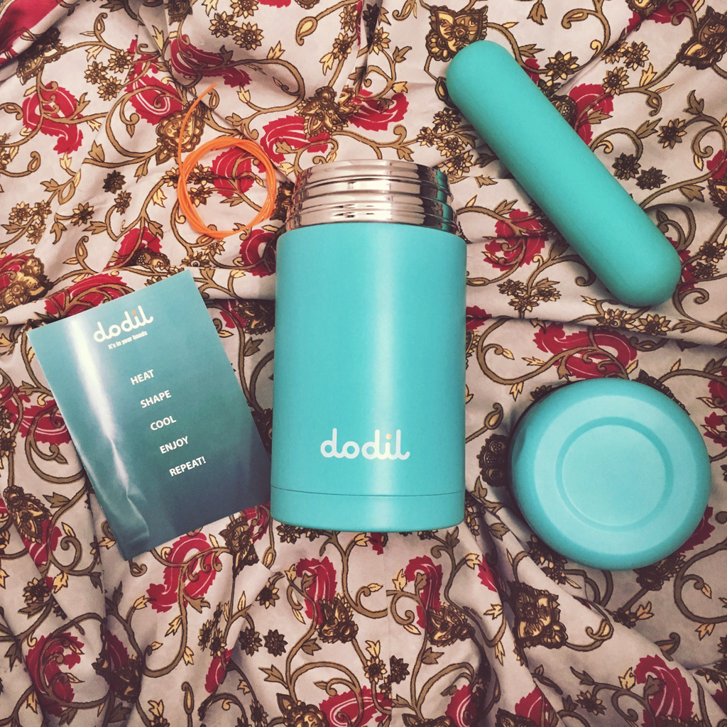 above photo of Dodil thermos contents - dildo, instruction book, string