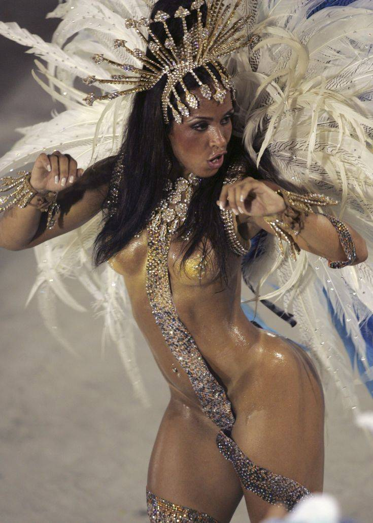 ** EDS NOTE NUDITY ** A dancer performs during the Vila Isabel samba school carnival parade at the Sambodrome in Rio de Janeiro, Monday, Feb. 23, 2009. (AP Photo/Ricardo Moraes)