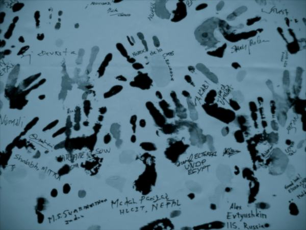 Hand prints of different women on a chart paper, with locations written under each of the hand print to indicate site of sexual harassment