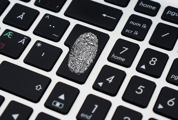 Enter key on a keyboard with a white thumbprint on it