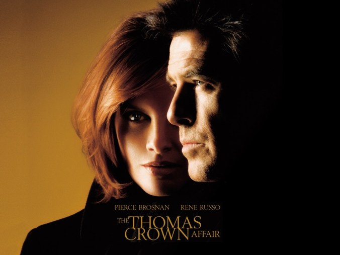 The Thomas Crown Affair poster, showing Pierce Brosnan in profile in front of Rene Russo facing forward against an orange background