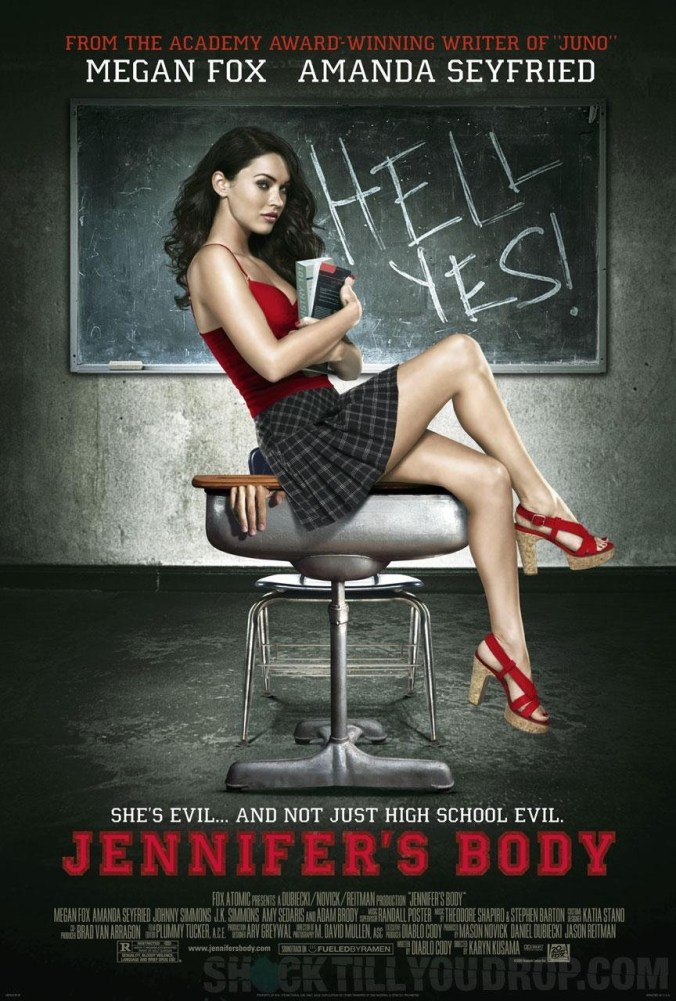 Jennifer's Body poster, showing Megan Fox in a short cheerleader skirt sat in front of a blackboard that says 'Hell yes!'