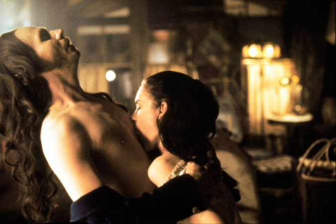 An image from Dracula, showing Mina drinking blood from Dracula's chest