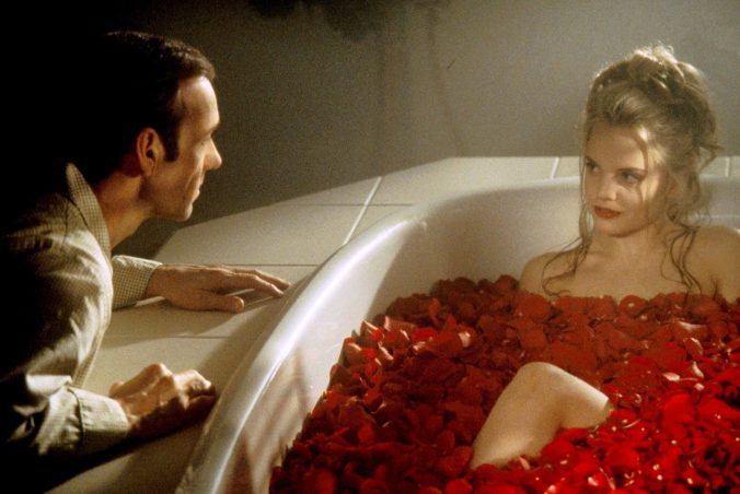 An image from American Beauty of Lester looking at Angela in a bath of rose petals