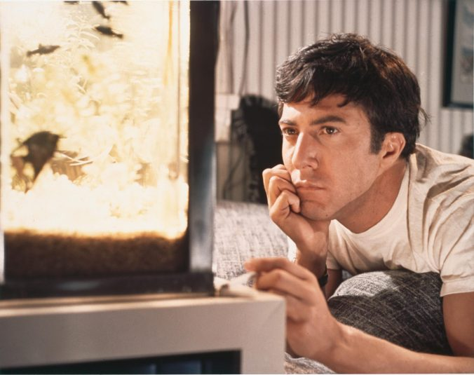 An image from the Graduate showing Benjamin starring into space