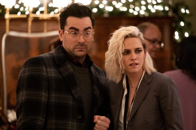 Abby and John looking surprised. An image from Happiest Season