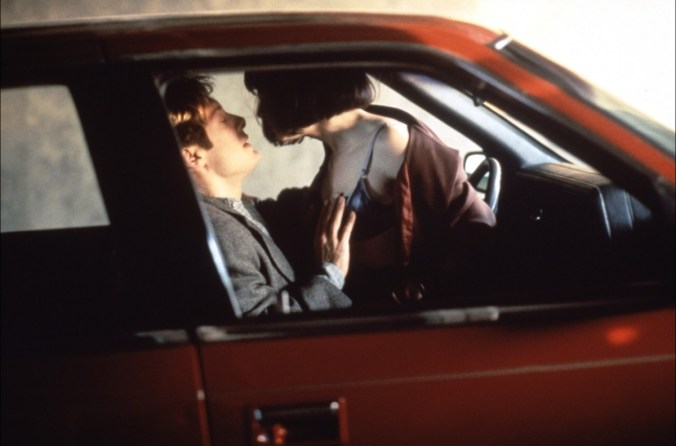 An image from Crash of Spader and Hunter about to have sex in a car