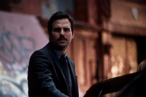An image from In the Cut of Ruffalo as Malloy, with a bizarre handlebar moustache