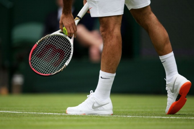 LONDON, ENGLAND - JUNE 24: Roger Federer of Switzerland' trainers during his gentlemen's singles first round match against Victor Hanescu of Romania on day one of the Wimbledon Lawn Tennis Championships at the All England Lawn Tennis and Croquet Club on June 24, 2013 in London, England. (Photo by Clive Brunskill/Getty Images)