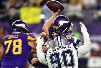 Minnesota Vikings quarterback Sam Bradford is pressured by Dallas Cowboys defensive end Demarcus Lawrence in the first quarter at U.S. Bank Stadium on Thursday, Dec. 1, 2016. (Pioneer Press: John Autey)
