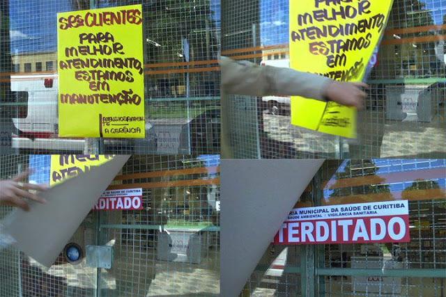 cartaz escondendo interditado da vigilancia sanitaria