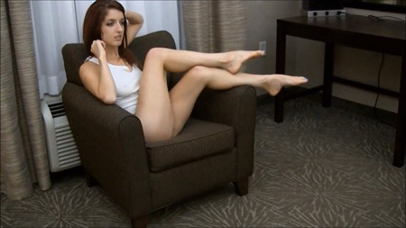 Slim brunette Lilly is showing off her cute legs on the couch