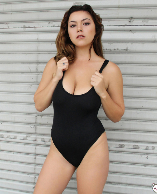 Hot girl in a leotard with cleavage on display