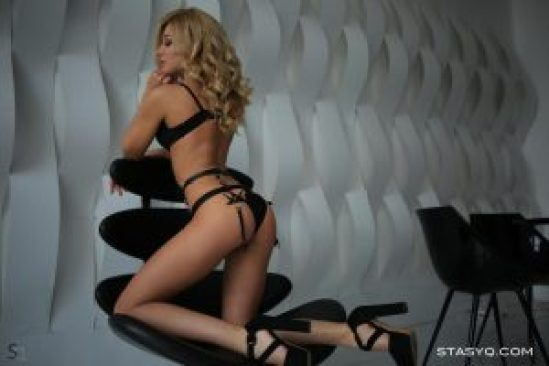Sexy DollyQ kneeling on a chair/StacyQ