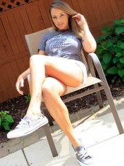 Nikki Sims in white shorts and t-shirt