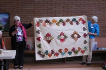 Suzanne and Anne, with Quilt of Valour