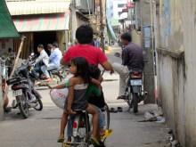 Three kids on a bike!