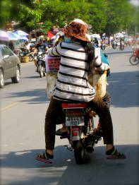 EVERY time I see this it cracks me up. The balancing act of carrying all the extra luggage on the moto!