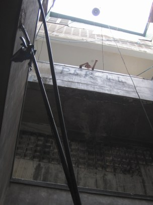 People around the world get great entertainment for dropping things from high places. This kid was bending paper so it spun as it floated all the way down the many levels of stairwells in this complex.