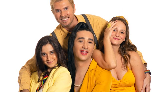 Four people dressed in yellow cuddling