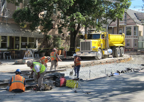 SFMTA capital crew ripping up the existing street and replacing track. Photos: Matthew Roth