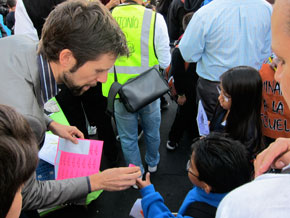 Nick Kaestner, SFUSD Director of Sustainability, handing out stickers to kids who walked to school on Wednesday. Photo: Matthew Roth