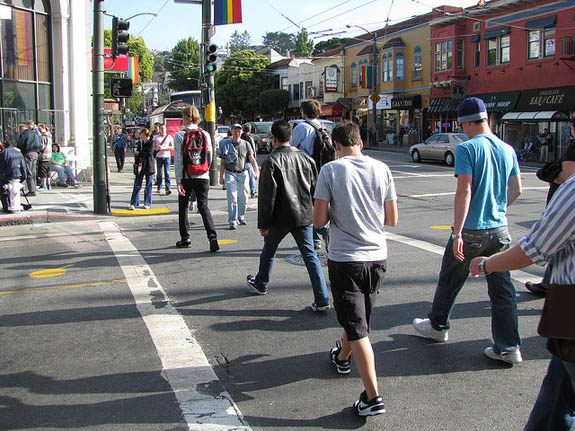 Pedestrians crowd one of the crosswalks on 18th Street at Castro. Wiener wants a pedestrian scramble installed at this intersection. Photo: Bryan Goebel