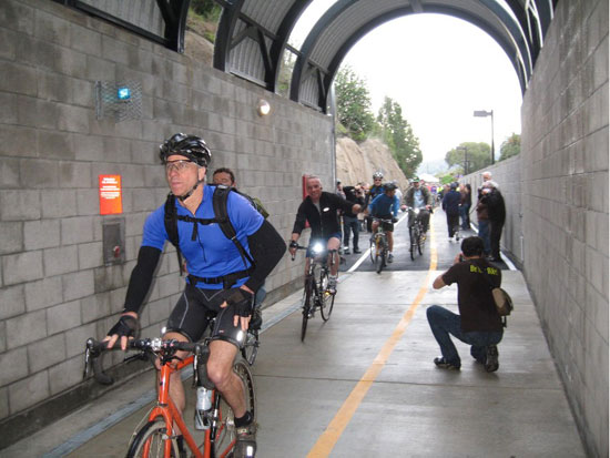 Some of the first cyclists to ride through the tunnel after the ceremonial opening. Photos: Tom Murphy