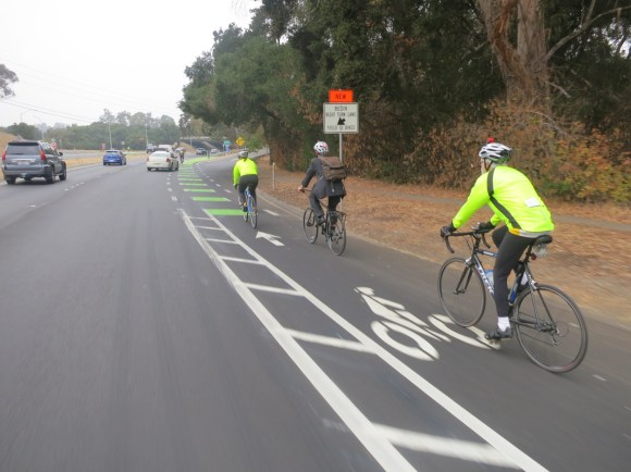 Cyclists travel north on Alpine Road in the new green and buffered bike lanes at Highway 280. Photo: Andrew Boone