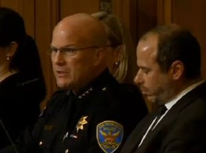 SFPD Chief Greg Suhr speaks at the hearing alongside SFMTA Director Ed Reiskin. Photo: ##http://sanfrancisco.cbslocal.com/2014/01/17/san-francisco-pledges-to-boost-traffic-safety-after-deadly-crashes/##CBS 5##
