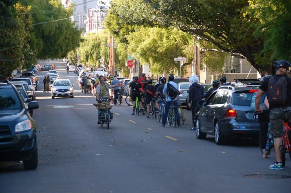 "At yesterday's ""stop-in"" on the Wiggle, bike commuters queued up for over a block to make a full stop at Steiner and Waller Streets. Photo: Aaron Bialick"