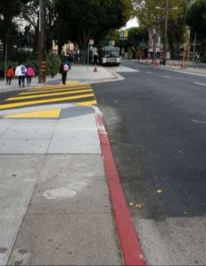 """A sidewalk extension on Columbus Avenue at Washington Square Park. One man complained yesterday that """"there should be a warning saying that you are now much closer"""" to motor traffic. Photo: SFMTA"""
