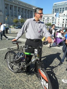 John Avalos and his bike during a campaign event