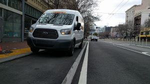 Delivery truck blocking a new raised bike lane on Market. Photo: Roger Rudick