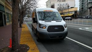 DHL truck parked on raised Market Street Bike Lane. Photo: Roger Rudick