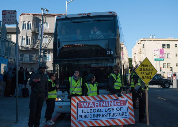 "Protesters block a ""Google Bus."" Data from Facebook suggests more people are driving as a result of SFMTA restrictions on Tech Shuttle routes. Photo: Chris Martin"