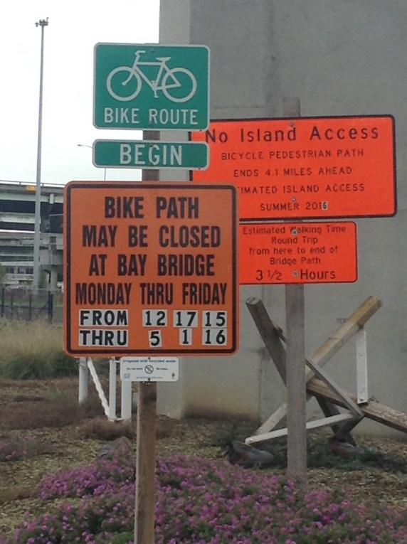 Old signs warn that the bridge path may be closed on weekdays; they haven't been updated to reflect Caltrans' recent announcement.