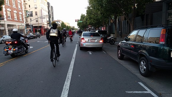 As is nearly always the case, cyclists had to navigate around this car illegally stopped in the bike lane. Photo: Streetsblog